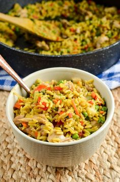Delicious Low Syn Coconut Chicken Curry Rice all in one bowl and packed with flavour. A perfect light meal which the whole family will enjoy.
