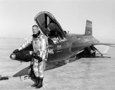 This photograph shows Neil Armstrong next to the X-15 rocket-powered aircraft after a research flight. He was one of only 12 pilots to fly t...