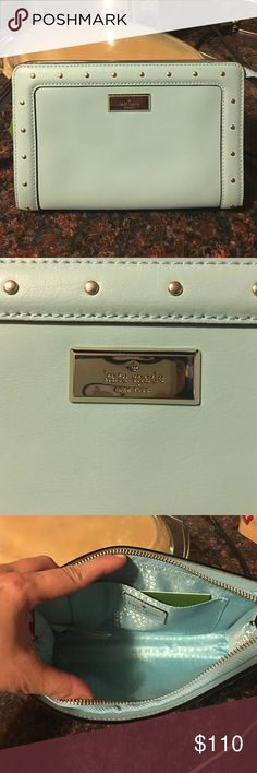 Authentic Kate Spade wristlet Brand NWT. Authentic Kate Spade large size wristlet. Perfect stocking stuffers or a gift. Color is sea form green/bluish with gold hardware. kate spade Bags Clutches & Wristlets