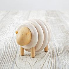 Shop Sheep Lacing Game.  There's more to this little sheep than meets the eye.  Assemble the sheep in corresponding order, from head to tail.  Match the 5 rings to the 5 colored beads to piece it all together.