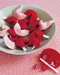 Let your shower guests know you feel fortunate to have them at the party with these charming pink and red fortune cookies filled with treats or special messages. Make an extra-special bunch for the bride-to-be and ask guests to write special fortunes for her.