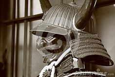 Elements of Japanese armor - samurai helmet with Buffalo horns and protective mask. Sepia. Stylized old photo