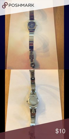 """Fossil Steel Women's Watch This beautiful watch has been well loved but still has a lot of life left.  It does need a new battery and the band has some scratches showing sign of wear (more on the """"top""""-in pic, than bottom). Beautiful blue face and extra links. Love the item but not the price? Please make an offer...all reasonable offers will be considered!! Fossil Accessories Watches"""