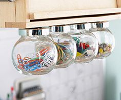 Store and display small office supplies, such as paper clips and pushpins, in these hanging glass bulbs. Simply unscrew the bulb from the lid and throw in your supplies for easy storage.