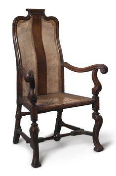 A George I walnut and caned armchair, circa 1720 backrail with journeyman's mark inscribed GC height 46 1/4 in.