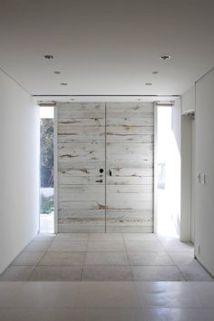 modern, distressed, white-washed doors. Really like this entrance!!