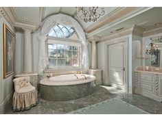 French Bathroom - Bay Colony Golf Estates - Green - feminine - chandelier - soaking tub