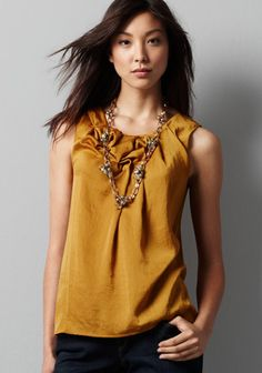 Twisted Neck Blouse.  Love the color of this Ann Taylor Loft blouse ($50) with a detailed neckline and exposed zipper in the back.  Great with jeans or paired with a suit for the office.