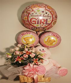 "A Star Is BornBaby Girl Gift Ensemble Beautiful Stargazer lillies and Rose arrangement in shades of pink, a soft cuddley plush bear with a singing balloon. What a great way to welcome the new ""Star"" in your life"