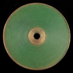 Chichester Bell, A recording of Hamlet's Soliloquy made vertically in a green-colored wax composition on a brass backing.