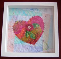 A finished heart. Fused, embellished and quilted