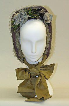 "1863 ... Bonnet ... cotton, silk & metal ... Length: 7.75"" ... American ... at Metropolitan Museum of Art ... photo 2"