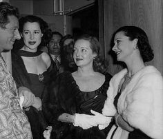 Vivien Leigh, Bette Davis and Kitty Carlisle Hart visiting Danny Kaye backstage after his one-man show in London.  Vivien and Bette, Scarlett O'Hara and Jezebel, in the same room together. When Movie Queens meet. Too much.
