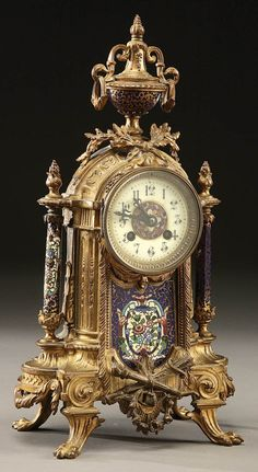 306: A FRENCH ORMOLU AND ENAMELED MANTLE CLOCK : Lot 306