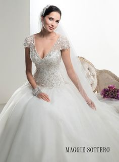 Timeless and elegant is this organza ballgown, Dawson by Maggie Sottero, with dazzling beaded Swarovski crystal bodice. Finished with plunging V-back and neckline.