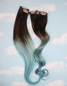 Please read all of the information below before starting a conversation between seller and buyer. Thanks! Light Blue Dip Dyes of Brunette* (I can do this same color combination on light blonde and black hair.) Please let me know the color base under comments to seller.* This listing is for a set of 10 2 wide and 20- 22 long100% human hair extensions. Each extension is 5-6 grams of hair. The weft is doubled and sewn together. Then dip dyed and a clip is sewn on. If you have shorter hair…