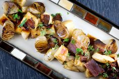 Quince with cipollini onions and bacon recipe (Photo: Lisa Wiltse for The New York Times)