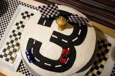 "Race car birthday cake- I did the 3 road but frosted the cake with green ""grass on top... super cute!"