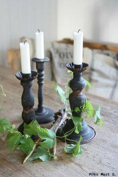 black painted metal candlesticks