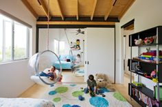 A shared kids room becomes virtually fight-proof thanks to a sliding wall, which connects the two spaces.