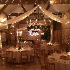 The South Barn with stunning winter wedding decor this week. Ivy clad candelabra… The South Barn with stunning winter wedding decor this week. Ivy clad candelabras, drapes lined with fairy lights, gobo projection on the… Winter Wedding Decorations, Wedding Themes, Our Wedding, Dream Wedding, Wedding Week, Light Wedding, Wedding Reception, Wedding Parties, Wedding Advice