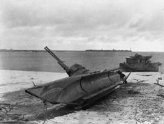 The Royal Navy during the Second World War Bow view of a German Biber type Midget U-boat high and dry on a European beach after being forced into capture by the Royal Navy.