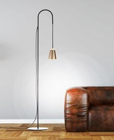 The Chaplin Floor Lamp in Black / Gold. Adjustable length, LED. Design by Benjamin Hopf. For more colors and info go to www.formagenda.com