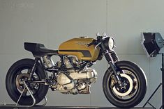 """This Ducati Pantah custom is pretty snazzy for a 125cc scooter! I also love the builder's description: """"I wanted it to look like it was found in a shed in Bologna... A futuristic design study for a 1981 motor show, but never displayed… the work of a designer who was a café racer fan, but could not convince the Ducati factory."""""""