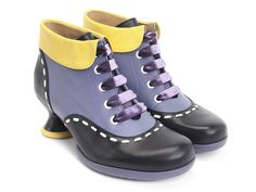 """The Enneagram Family's comeback party is far from over. Cunningly adorable, The Investigator is a thoroughly studious lace-up ankle boot with a cute collar, exaggerated contrast interlacing and velvet ribbon laces. Despite the moniker, you really won't have to think too hard about whether to put them on. With rubber soles and a 2"""" vintage Minstrel heel, they're good to go any day of the week!Be your true self."""