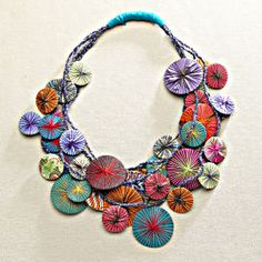 DIY made from scraps of fabric and colored thread.