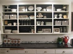 Chalkboard-backed upper cabinets.