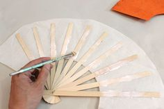 Learn how to make Japanese fans for celebrations or decor. Fashioned out of decorative paper and wood, it's an easy DIY. Easy Diy Crafts, Jar Crafts, Fun Diy, Hand Held Fan, Hand Fans, Accessoires Barbie, Crochet Flower Tutorial, Smocking Tutorial, Diy Fan