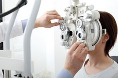 woman having an eye test at the opticians.