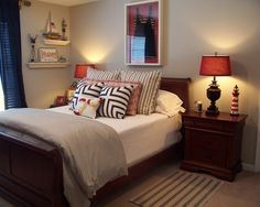 Guest room (or kid's room) that was created after finding a vintage swimsuit on ebay which I framed to use as art. Pale gray walls are a nice backdrop for the navy, red and white color scheme. by Kim Nichols