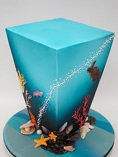 Aqua colored sea themed cake cake with coral and shells... upside down pyramid