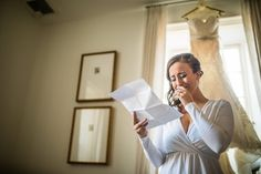 Bride reads emotional letter from her brother during bridal prep at the Farm House by the venue at The Farm at Eagles Ridge in Lancaster, PA.  www.lauranapoliphotography.com  Philadelphia Wedding Photographer    Nicole and Corey Married Photo By Laura Napoli Photography