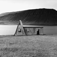 We wish you a good week with our Monday winner @getzpeter  #everydayiceland #woodhouse #blackwhite #bay #oldhouse #iceland #landscape #lagoon #noth #nothface #freedom #northatlantic #ocean #atlantic #atlanticocean #travel #beach #mountains #seaside #coast #seascape #rock #ísland #harmony #wildnature #nature #windows