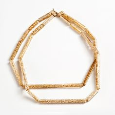 Dania Chelminsky Necklace: Long pearls links, 2013 Epoxy, pearls, 22k gold, gf 17 x 22 x 0.7 cm