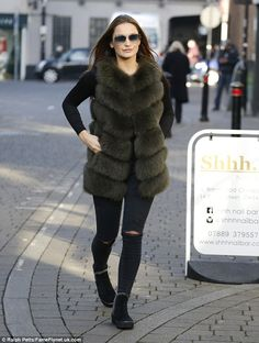 Sam Faiers wraps up warm in faux fur gilet after PA sacking denial | Daily Mail Online