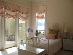 Relaxed Roman shades with relaxed pleated attached valance and fringe to replicate the bottom of the Roman .. nice effect - Savannah Drapery Company, Ltd.