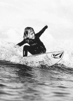 Little girl surfing