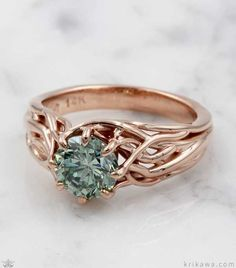 Embracing Tree Branch Engagement Ring is custom made in the metal and solitaire stone you want! Pictured here in 14k rose gold with a green diamond solitaire, how would you customize yours? Start the fun and easy design process today...