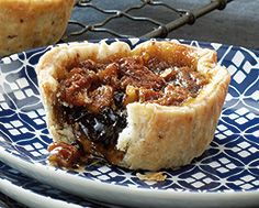 Gooey Maple Butter Tarts Recipe Maple syrup, currants and pecans are combined in these decadent tarts to produce an updated version of the Canadian classic. A rich flaky pecan pastry . Köstliche Desserts, Delicious Desserts, Dessert Recipes, Yummy Food, Lemon Desserts, Plated Desserts, Tart Recipes, Baking Recipes, Oven Recipes