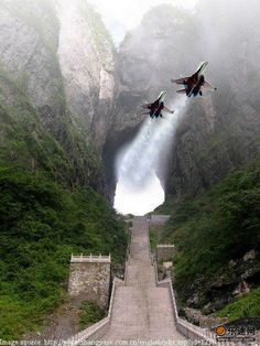 Travelogue of An Armchair Traveller: Gateway to Heaven - Tianmen Cave, China.I'm highly doubtful the Chinese government or Air Force would allow this, and certainly not with 2 jet fighters. Military Jets, Military Aircraft, Heavens Gate China, Fighter Aircraft, Fighter Jets, Air Fighter, Fighter Pilot, Tianmen Mountain, Jets