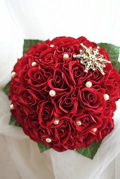 Lucy's bridal bouquet. Half open, classic red rose bouquet. Embellished with gold and diamonte brooch and rich cream teardrop pearls.