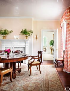 A 19th-century American Empire table and chairs converge in the dining room of this historic Kentucky home, which was renovated by Joel Barkley and Todd Klein for a young family. | archdigest.com