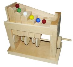 Franklin Phonetic School - My interpretation of a simple marble machine (plans by Steve Good Scroll Saw Workshop).  Crank it and the marbles go up the stairs, then roll down the side ramp to start the loop again.  http://woodworkingteachers.com/default.aspx?g=postst=1942p=2 Look through all 3 pages of projects.