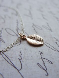 Tiny rose gold leaf necklace - small leaf rose gold necklace - tiny simple jewelry. $27.00, via Etsy.