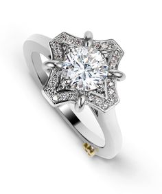 The Wonder engagement ring contains 31 diamonds, totaling 0.19ctw. Center stone sold separately, not included in price.