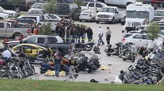 Authorities investigate a shooting in the parking lot of the Twin Peaks restaurant Sunday in Waco, Texas. Authorities say that the shootout victims were members of rival biker gangs that had gathered for a meeting.